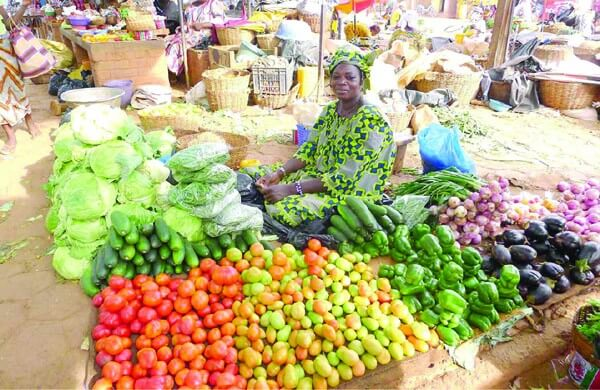 Market woman selling in Nigeria; How e-commerce in Nigeria needs to crack this same model of commerce online